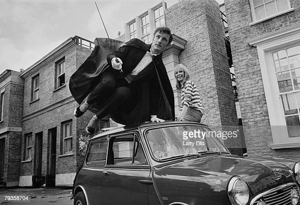 English actors Gerald Harper and Juliet Harmer in London during filming of the BBC adventure series 'Adam Adamant Lives' 19th May 1966 Harper plays...