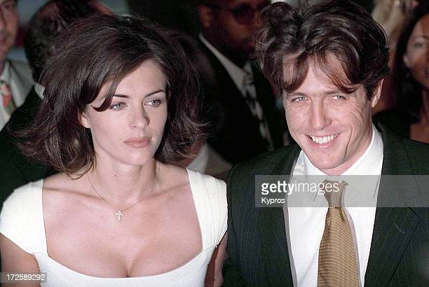 English actors Hugh Grant and Liz Hurley at the Los Angeles premiere of 'Nine Months', 11th July 1995.