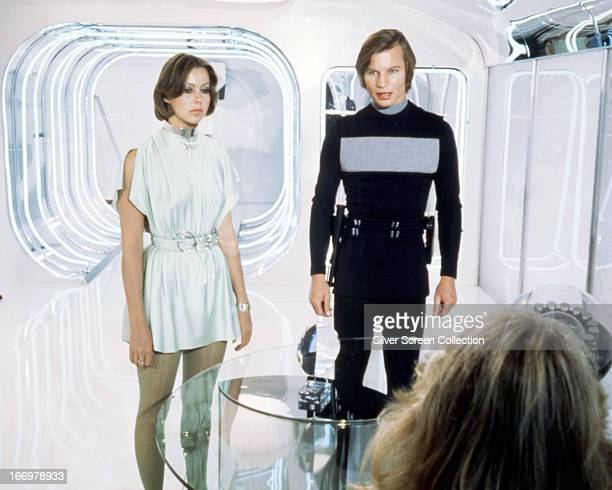 English actors Jenny Agutter and Michael York as Jessica 6 and Logan 5 in a publicity still from 'Logan's Run', directed by Michael Anderson, 1976.