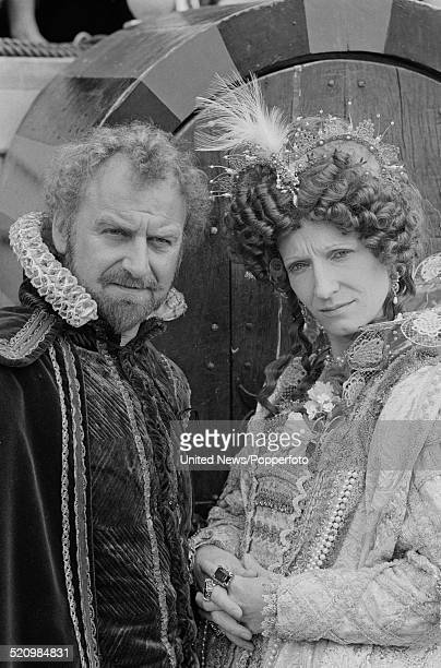 English actors John Thaw and Charlotte Cornwell pictured together dressed in character as Francis Drake and Queen Elizabeth I on the set of the...
