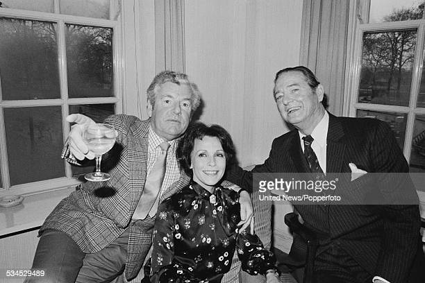 English actors Kenneth More and Claire Bloom, who appear together in the film 'In Praise of Love', pictured together with, on right, the dramatist...