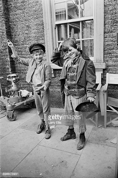 English actors Mark Lester and Jack Wild on the set of the musical film 'Oliver' based on the novel 'Oliver Twist' by Charles Dickens 3rd November...