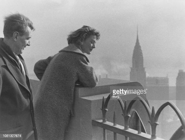 English actors Michael Redgrave and his daughter Vanessa looking at the view of Manhattan from the 'Top of the Rock' observation deck at 30...