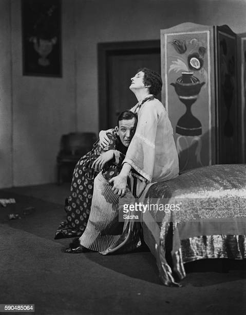 English actors Noel Coward and Lilian Braithwaite in a scene from Coward's 'The Vortex' at the Everyman Theatre in Hampstead London 1924 The play...