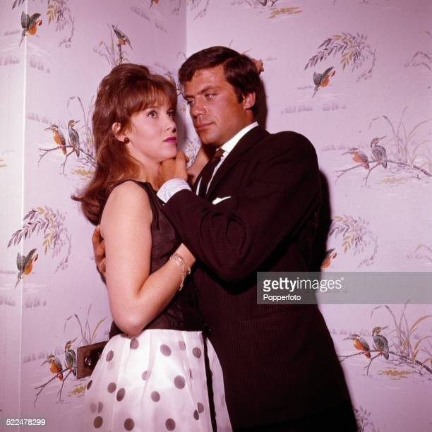 English actors Oliver Reed and Jane Merrow pictured together in a scene from the film 'The GirlGetters' aka 'The System' in AugustSeptember 1963