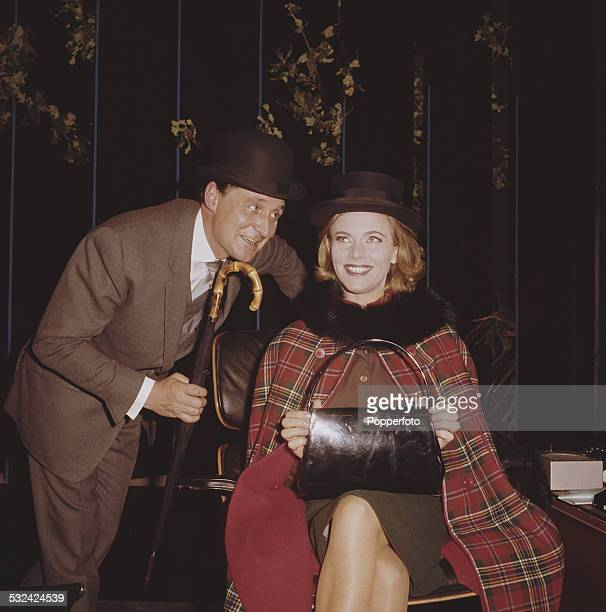 English actors Patrick Macnee and Honor Blackman pictured together in character as John Steed and Cathy Gale on the set of the television drama...