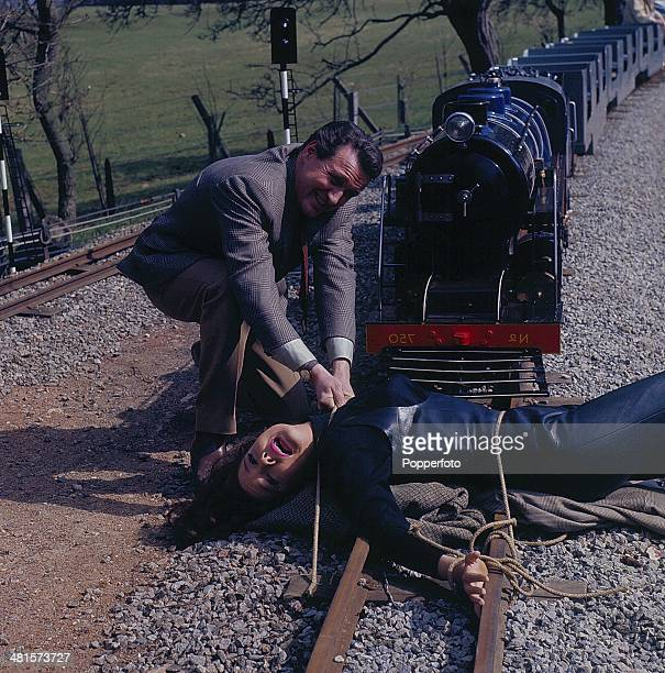 1968 English actors Patrick Macnee as 'John Steed' and Diana Rigg as 'Emma Peel' in a scene from the television series 'The Avengers' in 1968...