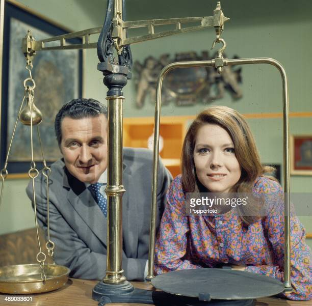 English actors Patrick Macnee as 'John Steed' and Diana Rigg as 'Emma Peel' posed on the set of the television series 'The Avengers' in 1967.