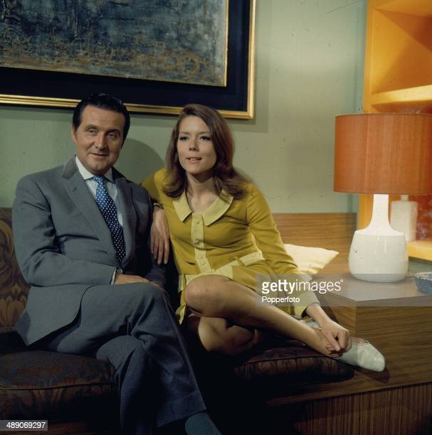 English actors Patrick Macnee as 'John Steed' and Diana Rigg as 'Emma Peel' posed on the set of the television series 'The Avengers' in 1968