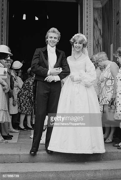 English actors Patrick Ryecart and Marsha Fitzalan stand together on the steps of a church following their wedding ceremony in London on 4th July 1977