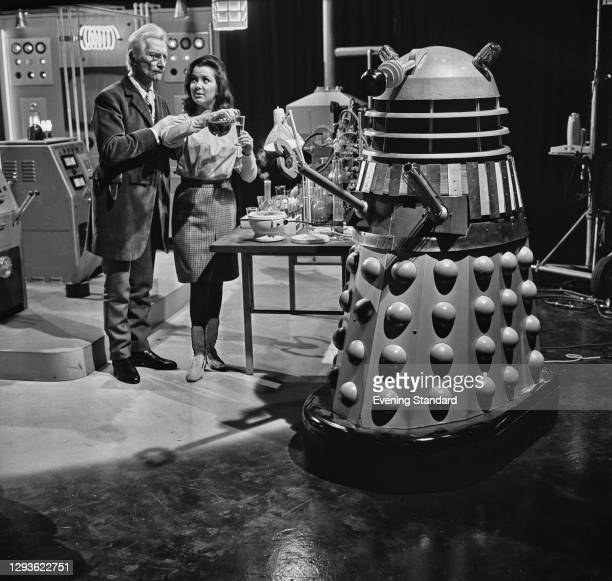 English actors Peter Cushing and Jill Curzon on the set of the science fiction film 'Daleks' Invasion Earth 2150 AD' at Shepperton Studios, UK, 1966.