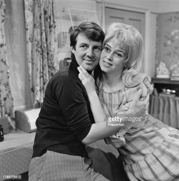 English actors Philip Lowrie and Gabrielle Drake in character as 'Dennis Tanner' and 'Inga Olsen' on the set of the long running television soap...