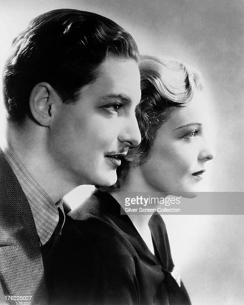 English actors Robert Donat and Madeleine Carroll in a promotional portrait for 'The 39 Steps' directed by Alfred Hitchcock 1935