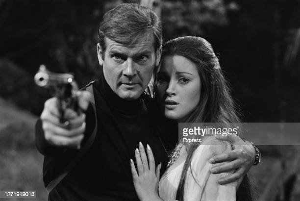English actors Roger Moore and Jane Seymour as superspy James Bond and tarot reader Solitaire in the Bond film 'Live And Let Die', being filmed at...