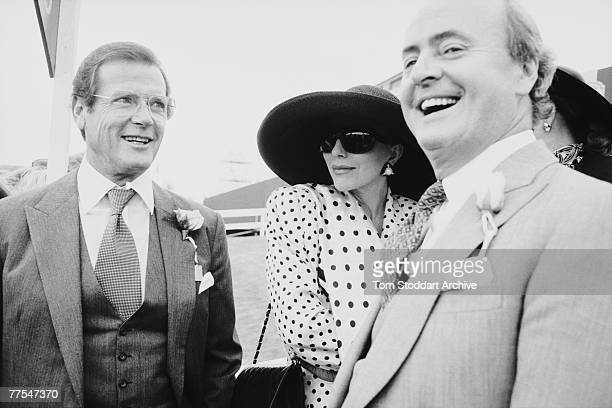 English actors Roger Moore and Joan Collins are amongst the spectators at the Epsom Derby in Surrey 8th June 1989