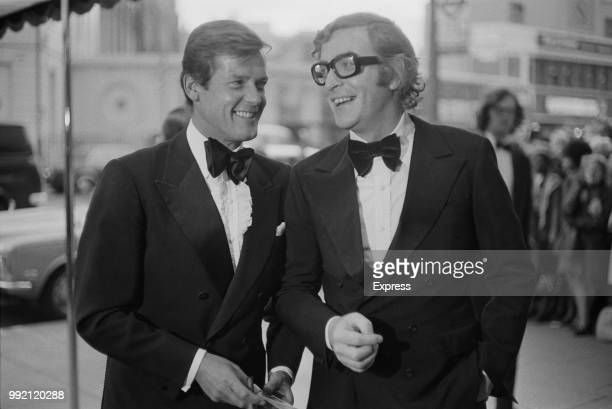 English actors Roger Moore and Michael Caine attend the premiere of mystery thriller film Sleuth at the Odeon cinema near Marble Arch, London, UK,...