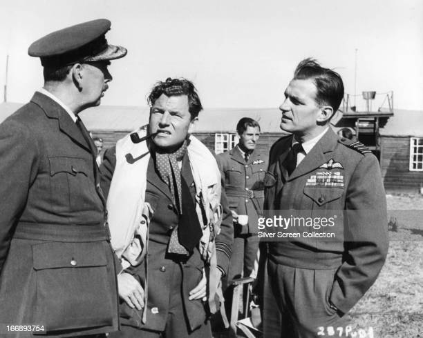English actors Ronald Adam as Air ViceMarshal LeighMallory Kenneth More as Douglas Bader and Michael Warre as Wing Commander Harry Day in 'Reach For...