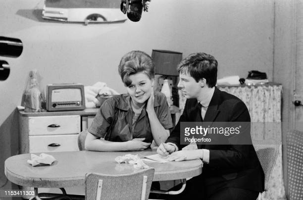 English actors Sandra Gough and Alan Rothwell pictured together playing the roles of Irma Ogden and David Barlow shooting a residential scene from...