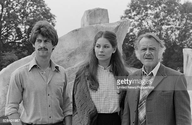 English actors Simon McCorkindale Barbara Kellerman and John Mills pictured together on set during filming of the science fiction television series...