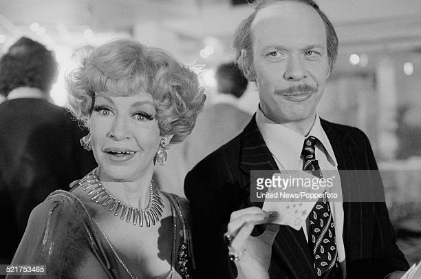 English actors Yootha Joyce and Brian Murphy pictured together in character as Mildred and George Roper on the set of the film version of the...