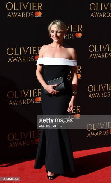 English actress Ali Bastian poses on the red carpet upon arrival to attend the 2017 Laurence Olivier Awards in London on April 9 2017 / AFP PHOTO /...