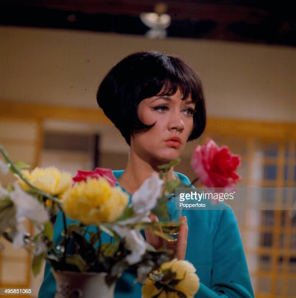 English actress Amanda Barrie pictured holding some flowers in a scene from the television series 'Danger Man' in 1968