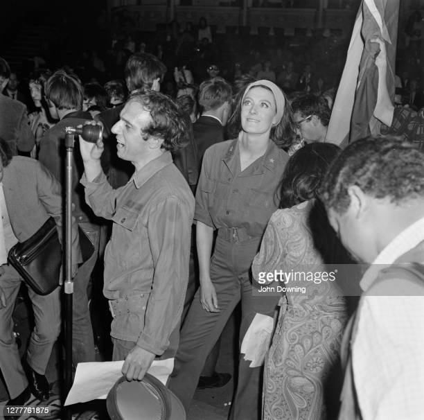 English actress and activist Vanessa Redgrave standing behind English poet Christopher Logue at the New Moon Carnival of Poetry in The Round at the...
