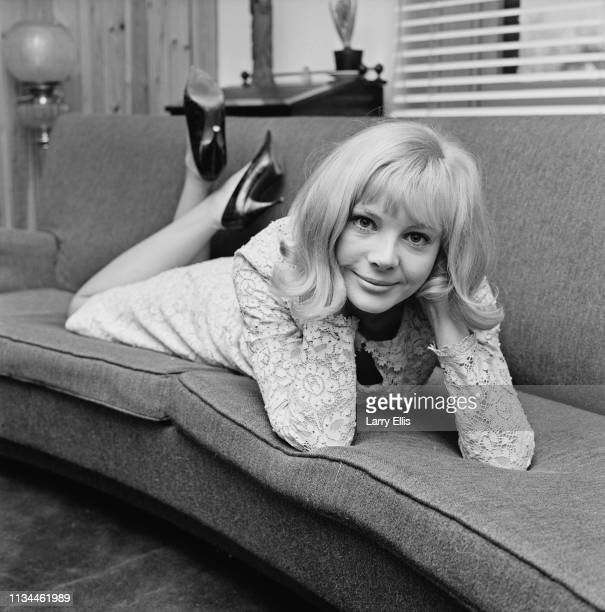 English actress and fashion model Barbara Ferris lying on a couch UK 5th January 1965