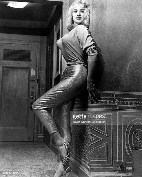 English actress and glamour model Sabrina wearing lurex trousers and a tight sweater circa 1957
