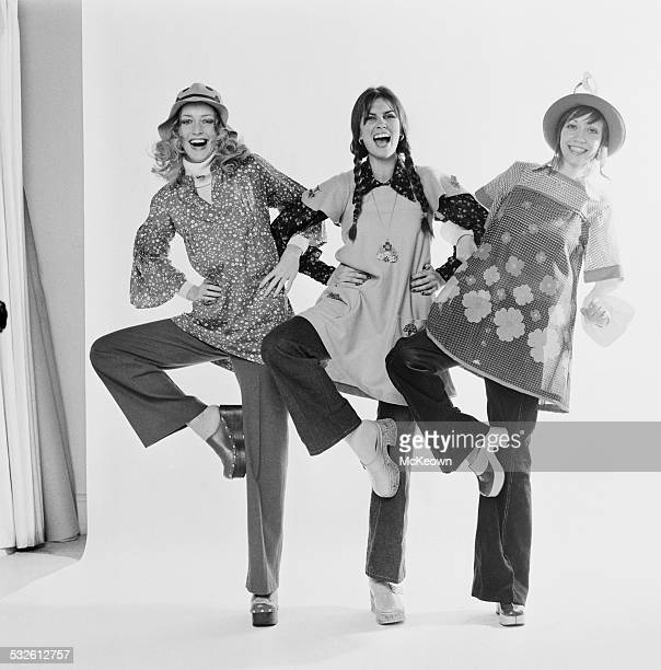 English actress and model Caroline Munro with fashion models Nikki Ross and Lula wearing smock style tunics 13th February 1972