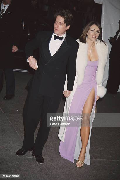 English actress and model, Elizabeth Hurley and English actor and film producer, Hugh Grant at the Met Costume Institute Benefit Gala, New York City,...
