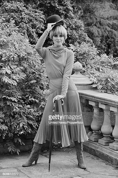 English actress and model Joanna Lumley posed holding a bowler hat at a press reception to launch the television series The New Avengers at Pinewood...