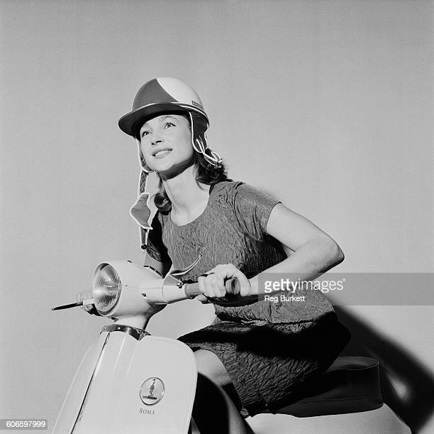 English actress and model Shirley Anne Field poses on a new Raleigh Roma scooter UK 11th November 1960