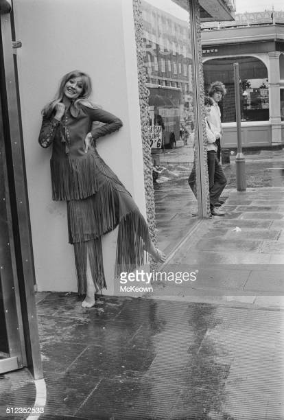 English actress and model Vicki Hodge wearing a fringed suede trouser suit designed by Ossie Clark 15th May 1969