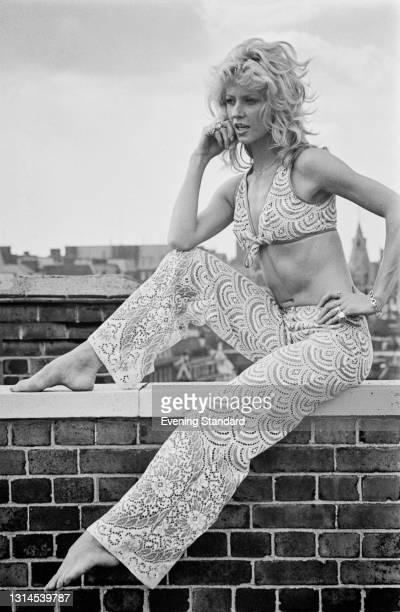 English actress and model Vicki Hodge wearing a patterned summer trouser suit with a bikini top, UK, 4th September 1973.