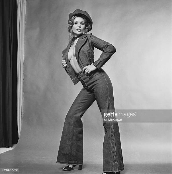 English actress and model Vivien Neves wearing a denim outfit of flared trousers and matching jacket 25th February 1971