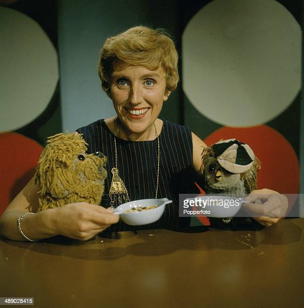 English actress and producer Marjorie Sigley posed with the puppets Ollie Beak and Fred Barker from the children's television series 'Five O'clock...