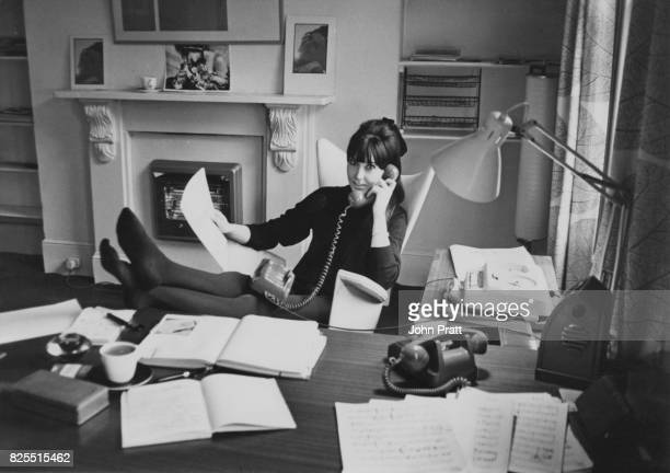 English actress and singer Anita Harris at work in the offices of her agency Competent Management in Holland Street London February 1965