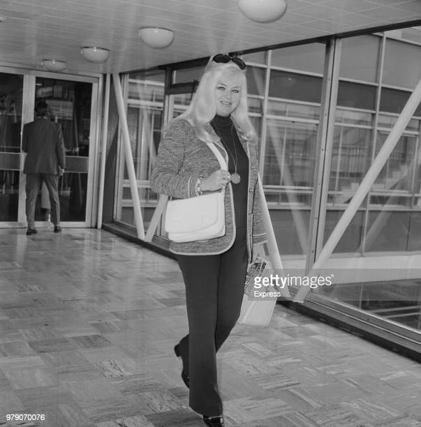 English actress and singer Diana Dors at Heathrow Airport, London, UK, 7th March 1974.