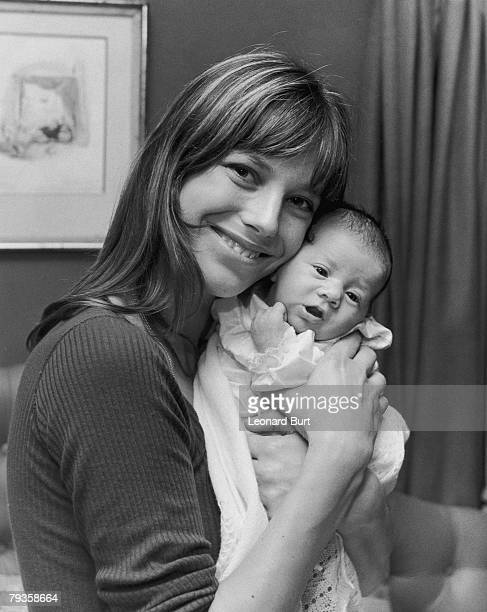 English actress and singer Jane Birkin with her new daughter Charlotte at their home in Cheyne Row Chelsea 12th August 1971 Charlotte's father is...