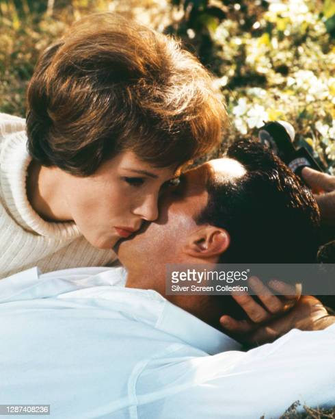 English actress and singer Julie Andrews as Emily Barham and American actor James Garner as Lieutenant Commander Charles Edward Madison of the US...