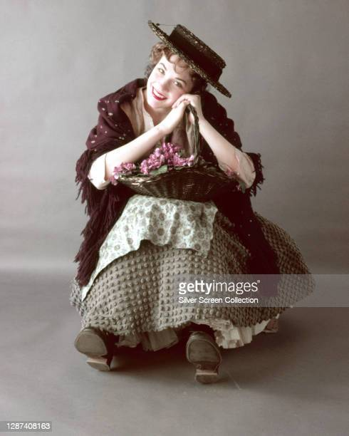 English actress and singer Julie Andrews plays Eliza Doolittle in the stage musical 'My Fair Lady', circa 1956.