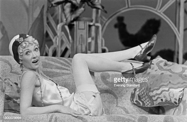 English actress and singer Mary Millar in stockings and suspenders, in the role of Poppy Dickie in the stage farce 'Popkiss' at the Globe Theatre in...