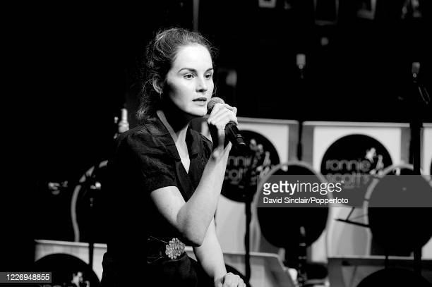 English actress and singer Michelle Dockery performs live on stage during the club's 50th birthday party at Ronnie Scott's Jazz Club in Soho, London...