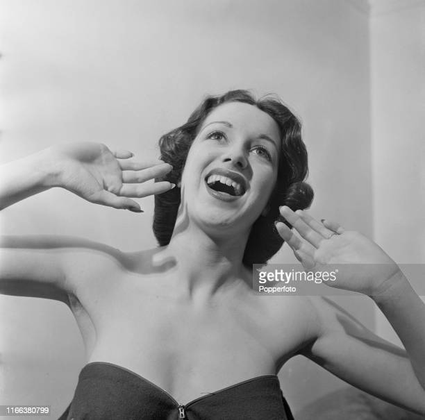 English actress and singer Pat Kirkwood pictured singing in rehearsal backstage prior to performing in the revue show 'Black Velvet' at the London...