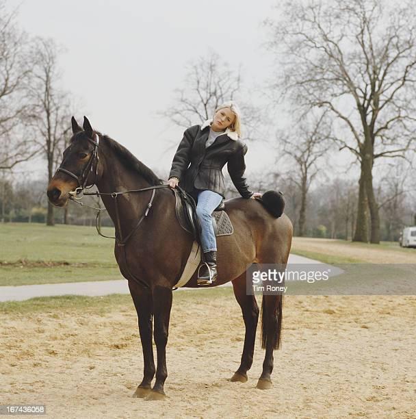 English actress and singer Patsy Kensit sitting on a horse circa 1995