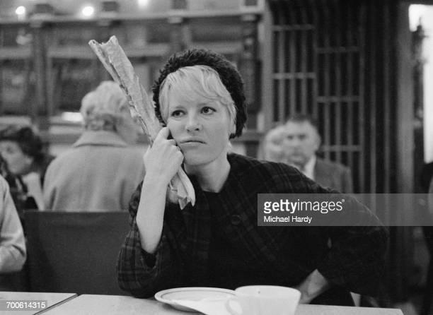 English actress and singer Petula Clark eating a baguette at a Lyons teahouse in Paris France 19th November 1960