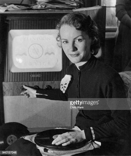 English actress and singer Petula Clark watches television at home in East Molesey, UK, March 1951.