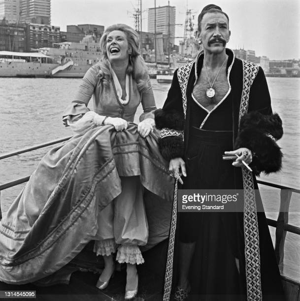 English actress and singer Sally Ann Howes and British actor Peter Wyngarde publicising their appearance in the stage musical 'The King and I' on a...