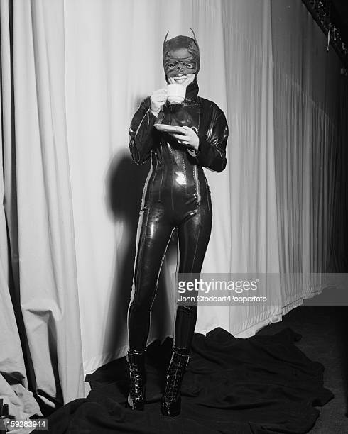 English actress Anna Friel drinks coffee in a Catwoman costume in 1994